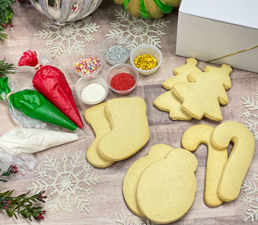 Christmas Cookie Decorating Kit By Sweet-Traders with red, green, and white frosting and assorted sprinkles.