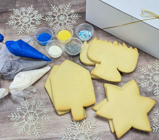 Hanukkah Cookie Decorating Kit By Sweet Traders with blue, white, and gray frosting and assortment of sprinkles.